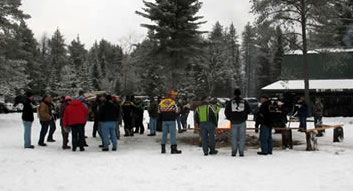 Members and guests of the Trackside Blazers Snowmobile Club enjoy a bonfire and pig roast every year. This is one of the many events you can enjoy when you join a club! Photo by Anne O'Dell